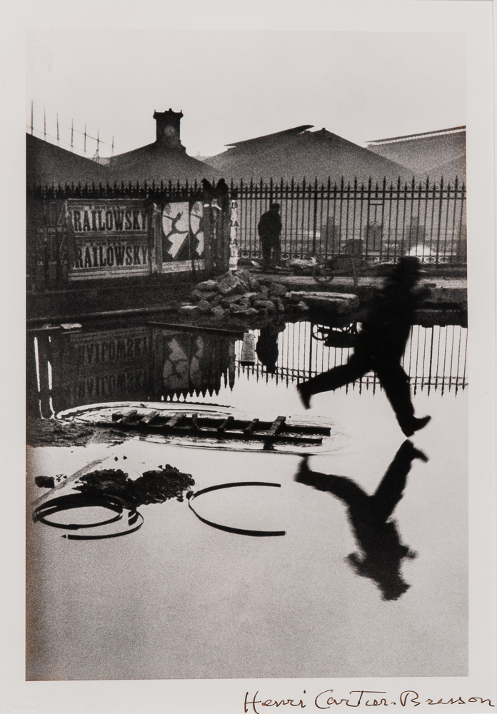 Henri Cartier-Bresson (French, 1908-2004), <i> Behind the Gare St. Lazare</i> (Lot 125, Estimate: $7,000-9,000)