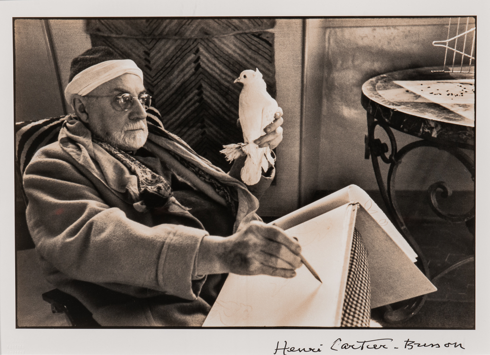 Henri Cartier-Bresson (French, 1908-2004), <i>Matisse Sketching</i> (Lot 126, Estimate: $4,000-6,000)