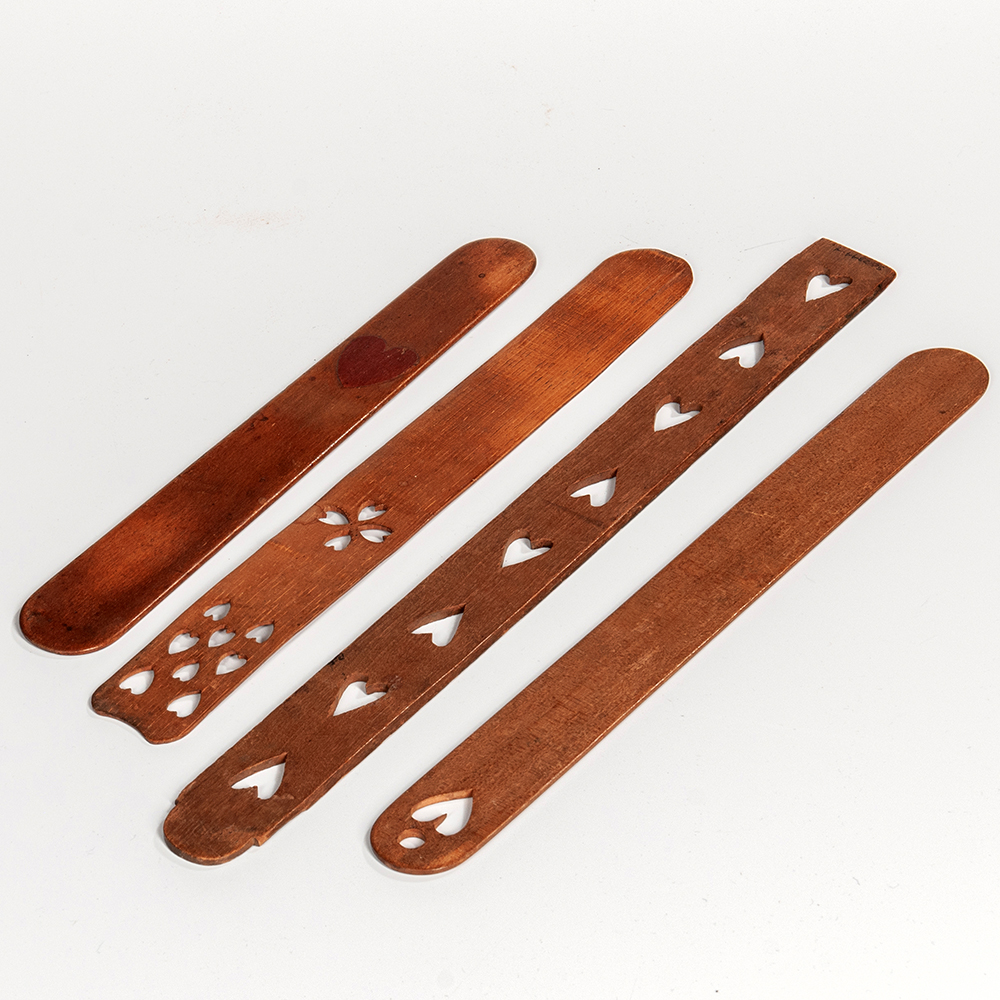 Four Heart-decorated Wooden Busks