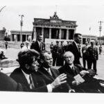 Will McBride (American, 1931-2015) <i>John F. Kennedy, Willy Brandt, Konrad Adenauer after visiting the Wall at the Brandenburg Gate, Berlin 1963</i>. (Lot 1017, Estimate: $400-600)