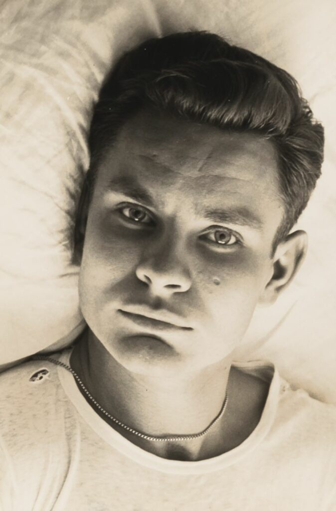 Chuck Howard lying in bed