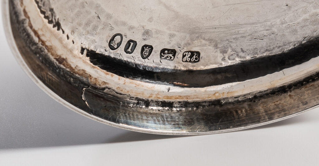 'HB' mark on the underside of a Hester Bateman silver cup