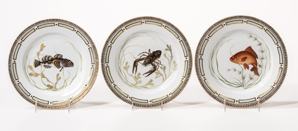 Three plates depicting seafood