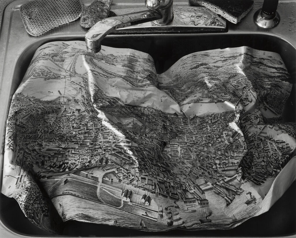 Abe Morell's photographMap in Sink showing a crinkled map in a sink