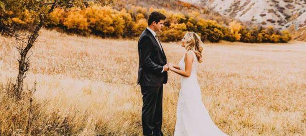 Utah-Wedding-Photographer-James-Erick-Photography-bride-and-groom-in-mountain-meadow
