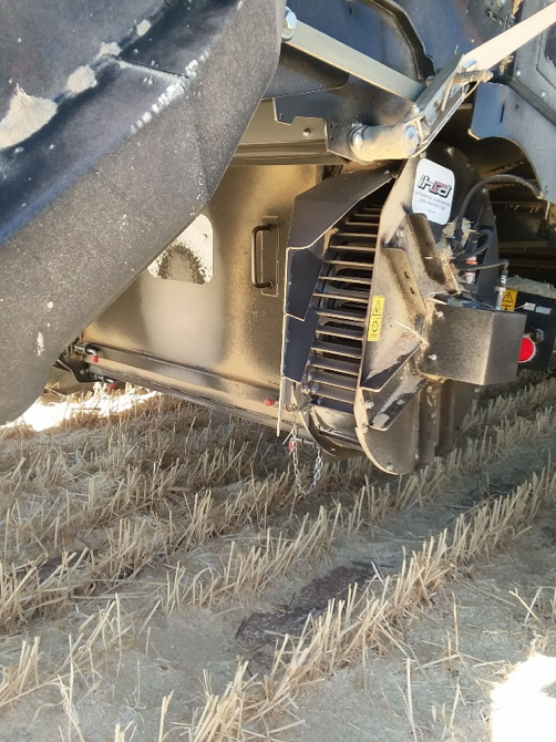 Integrated impact mill on back of combine.