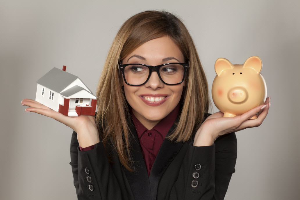 Girl-with-house-and-piggy-bank.jpg#asset