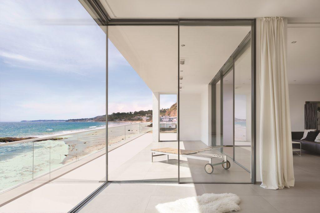 Minimal Framed Sliding Glass Wall System For Residential