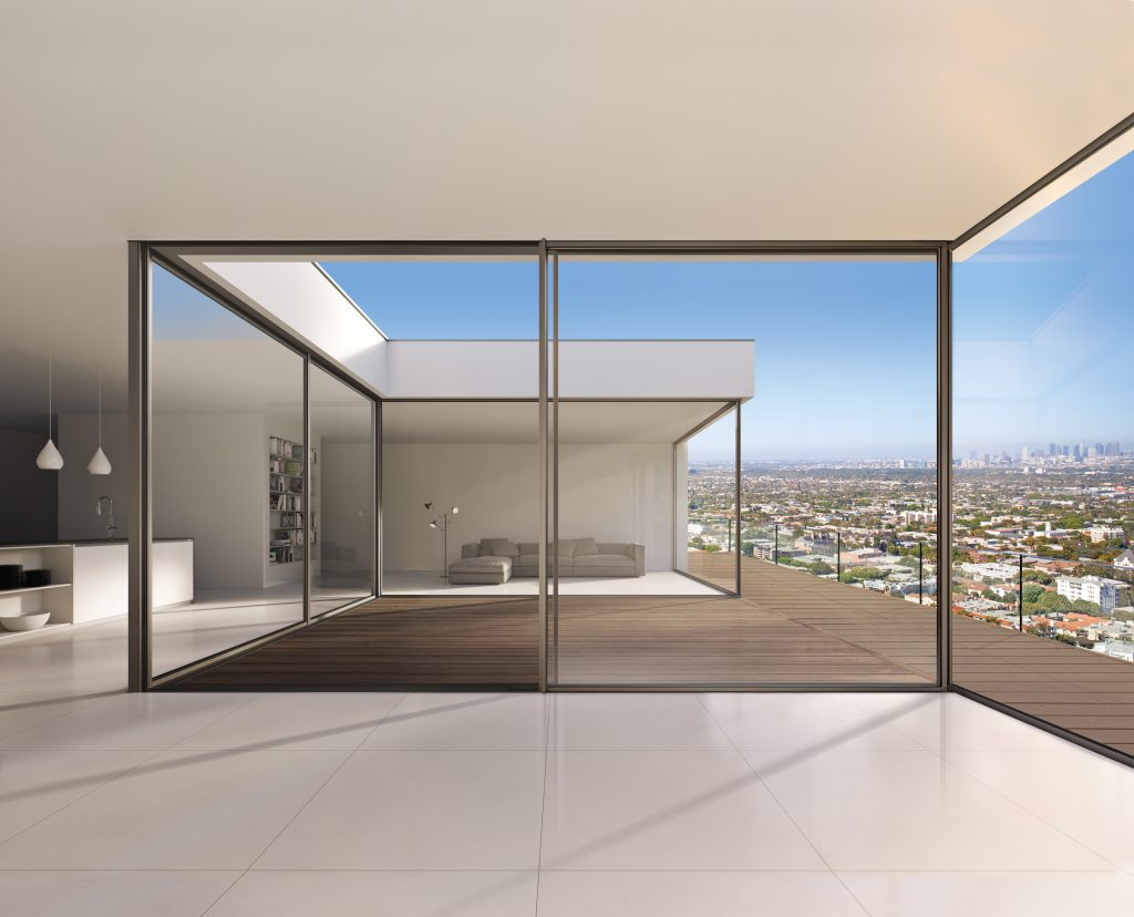 Minimal framed sliding glass wall system for residential for Sliding glass walls