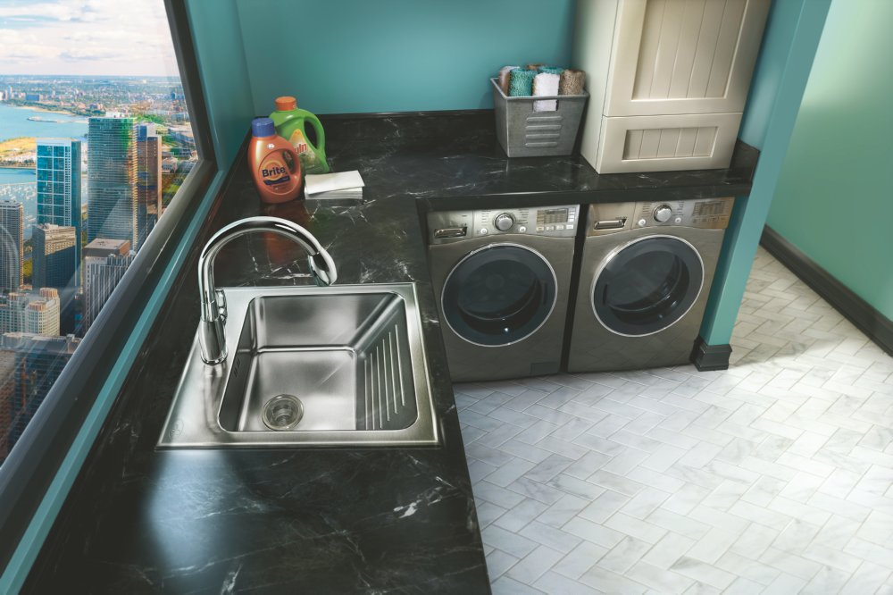 Laundry sink with built-in washboard