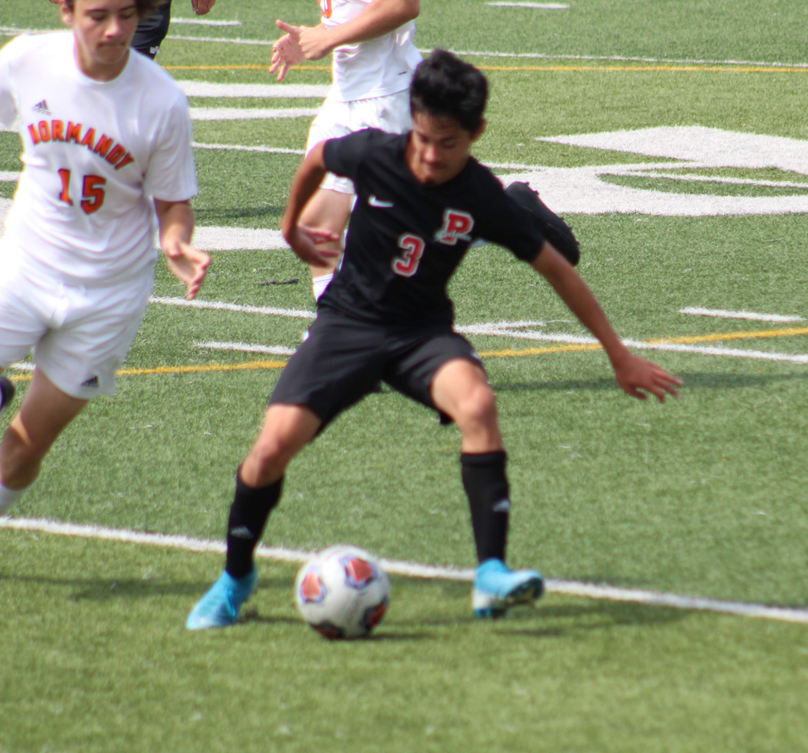 Action Pics from Redmen Boys Soccer vs Normandy