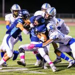 Titans end season on a rush, corral Mustangs for league title