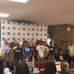 Boys Lacrosse celebrate 2 young men signing letters of intent