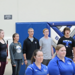 Students sing National Anthem at First Home Volleyball Game