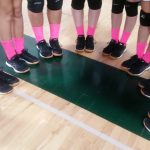Varsity Volleyball showing their support of Breast Cancer Awareness.