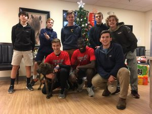 Members of Boys Soccer team donates supplies and time to the Humane Society