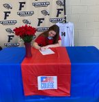 Annie Creery signs with Hill College.