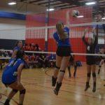 Volleyball girl hitting ball