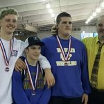 Wrestlers with medals.