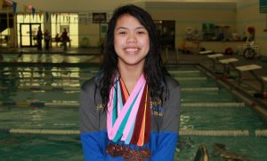 Girl swimmer with medals.