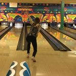 Girl bowler about to roll ball
