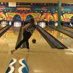 Girl bowler rolling ball
