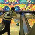 Boy bowler rolling ball