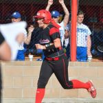 Leighton Withers helps the Lady Cardinals down Bryant 7-2
