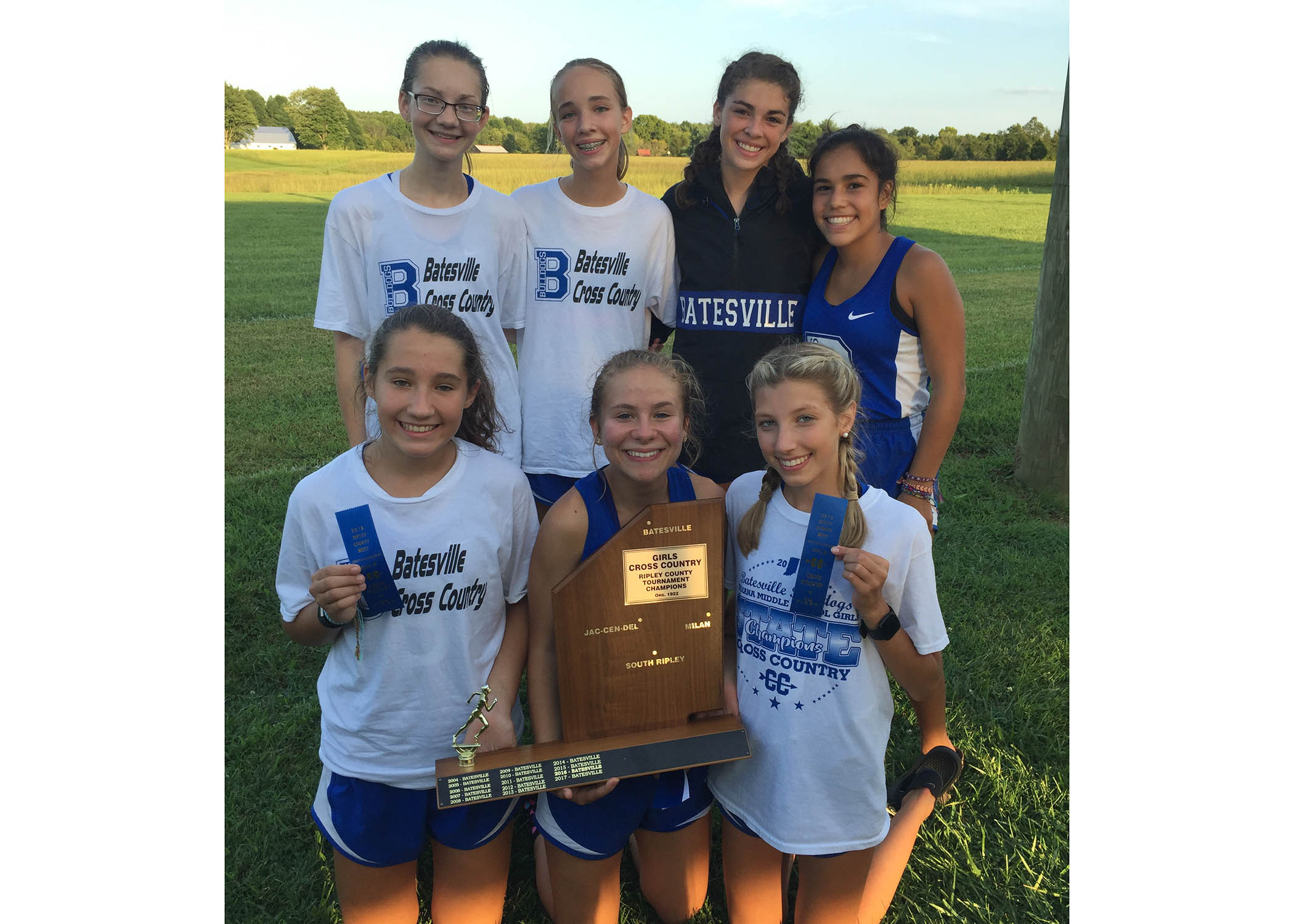 Cross country teams defend county titles