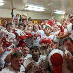 Varsity Football Gets 1st Win