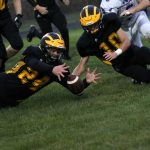 "#24 Danny Gregorich and #10 Derek Wireman Attempt to Recover a Blocked Punt Versus Caston at ""The Pit"" at Pioneer Junior-Senior High School"