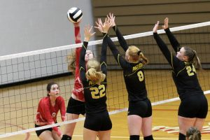 #22 Olivia Brooke, #8 Madison Blickenstaff & #24 Macee Weisenburger Implement a Triple Block at Knox Community High School