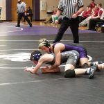 Wrestling: Cats split conference matches