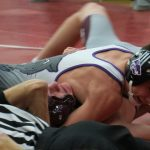 Wrestling: Cats fall twice in season opener