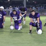 Football kneeling before game