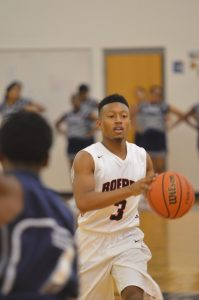 Boys Basketball District Opener – A Win for the Roughriders!