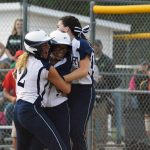 Softball team rallies to beat Memorial in extra innings