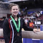 Kennedy Bican medals at state gymnastics meet!