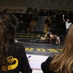 Athletic Trainers and Wrestlerettes: Team players from the sidelines