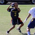 Flag football player holding the ball.