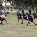 Multiple flag football players.