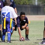 Flag football player holding ball.