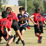 Flag football players running.