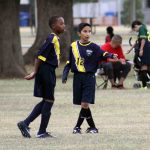 Two soccer players.