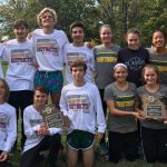 Flyers Capture District Cross Country Titles