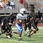 Football Falls to Cardinal Mooney