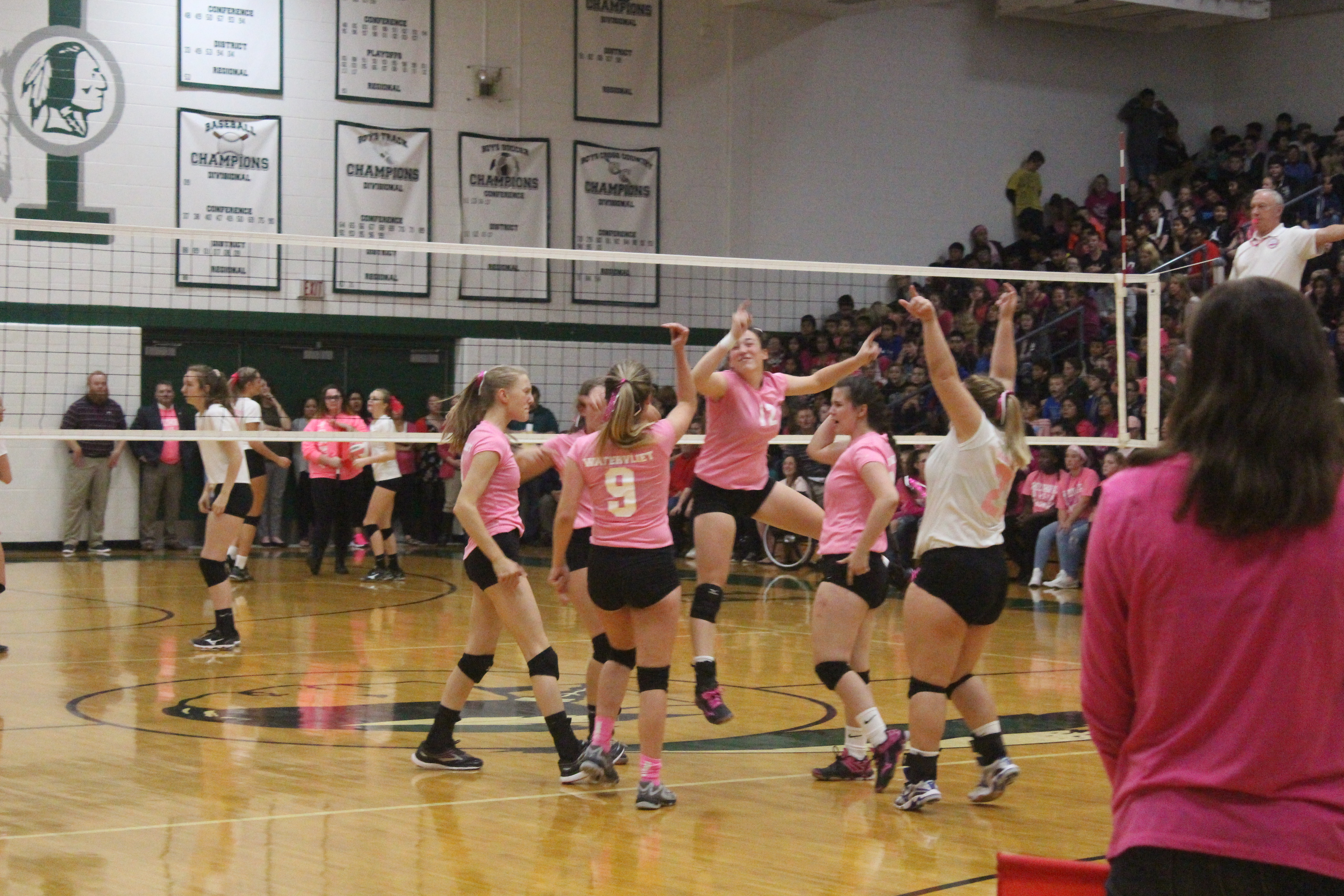 Varsity Girls win annual Dig Pink Event against Hartford