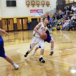 Bears fall to .500 with loss to Patriots; JV wins 62-47