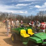 Frosh baseball players help prepare the game field