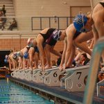 Rattler Swimmers Shine at District Meet